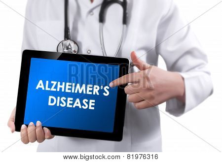 Doctor Showing Tablet With Alzheimer's Disease Text.