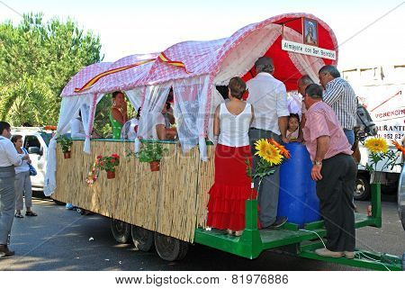 Spanish people travelling in a caravan.