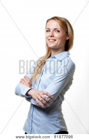 Young blond confident woman with folded arms