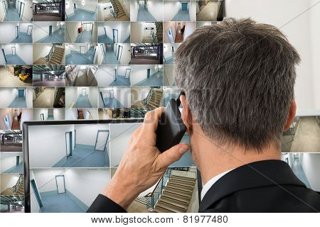 Security System Operator Looking At Monitors