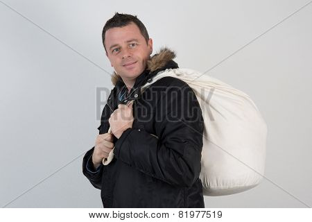 Man With A Big Back Pack And Wearing A Coat
