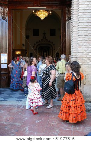 Spanish people entering a church, Marbella.