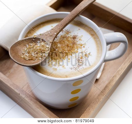 Brown Sugar On A Spoon And A Cup Of Coffee Cappuccino