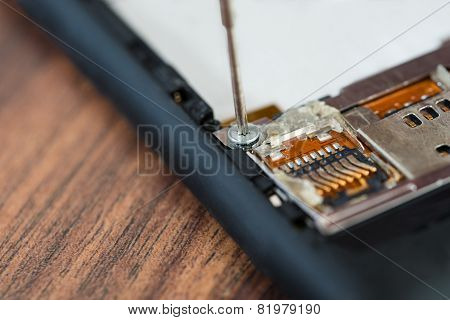 Technician Hand Fixing Cellphone