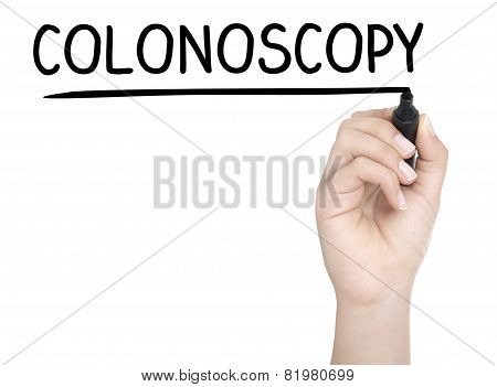 Hand With Pen Writing Colonoscopy On Whiteboard