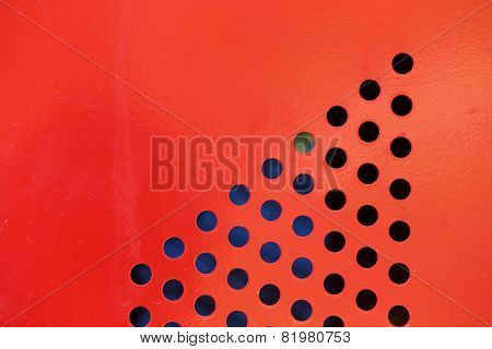 Background Of Red Steel Metal With Circle Perforated Holes