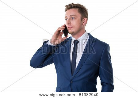 Confused businessman talking on cellphone