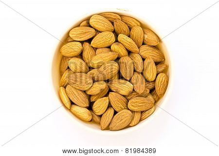 macro image capture of almonds kept in a cup