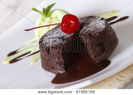 Delicious Chocolate Cake Fondant Close-up On A Plate. Horizontal