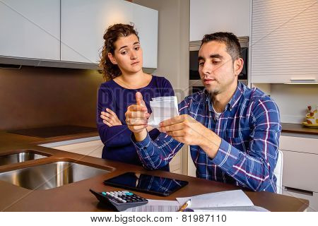Unemployed young couple with debts reviewing their bills