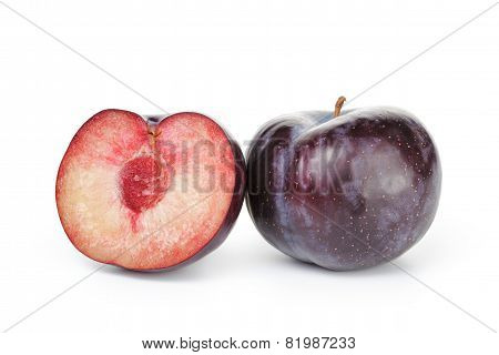 two ripe black plums isolated
