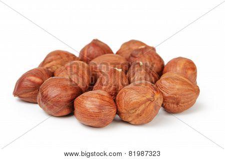 Heap of peeled hazelnuts isolated on white