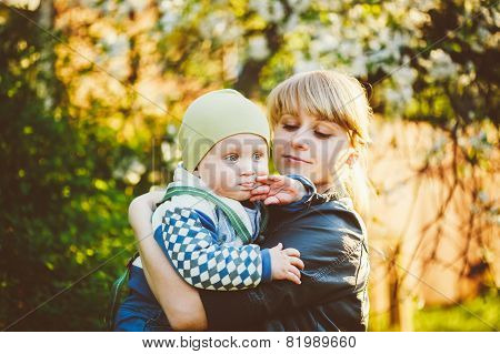 Young Woman Mother Hugging Her Baby Son