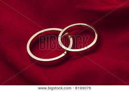 Golden Wedding Rings On Red Velvet