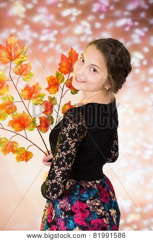 young pretty teenage girl with autumn leaves