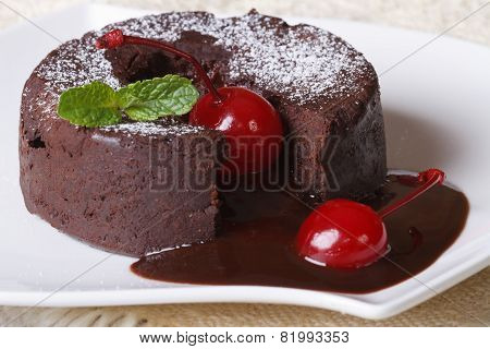 Fondant Chocolate Cake With Cherries And Mint On A Dish