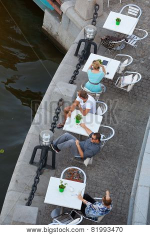People Sitting At Tables