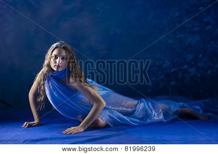 Young girl dance in blue costume.