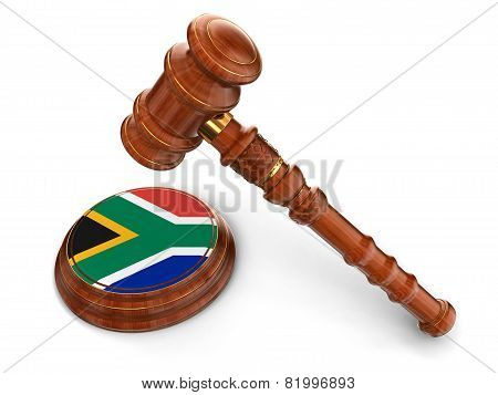 Wooden Mallet and flag of South African republic (clipping path included)