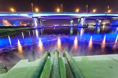 pic of sewage  - Sewage pipes discharging water into the Dubai Creek at night - JPG