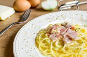 image of carbonara  - spaghetti carbonara on wooden table with ingredient - JPG