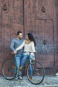 foto of enamored  - Middle aged couple enamored while watching an bike - JPG
