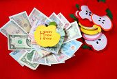 stock photo of  habits  - Red background of Vietnam Tet habit custom of Vietnamese on Tet is lucky money a Vietnam traditional culture child wish somebody a happy new year receive red envelope Tet also lunar new year - JPG