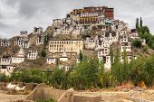 image of jammu kashmir  - Thiksay monastery with view of Himalayan mountians  - JPG