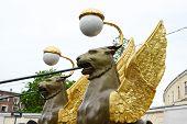image of metal sculpture  - Griffon sculpture of Bank bridge in St - JPG