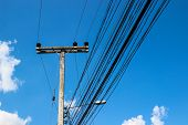 pic of utility pole  - electric pole and wire with blue sky background - JPG