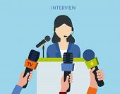 stock photo of politician  - Woman politician or businesswoman answering press questions in front of journalists holding microphones - JPG