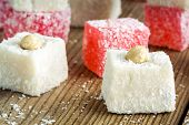 pic of ground nut  - Turkish Delight with coconut and nuts in a wooden bowl on a rustic background closeup - JPG
