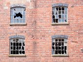 pic of derelict  - Old  derelict building with smashed and broken windows - JPG