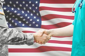 foto of army soldier  - Soldier and doctor shaking hands with flag on background  - JPG