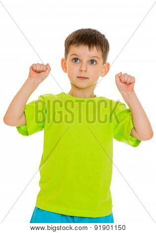 the little boy clenched his hands into fists