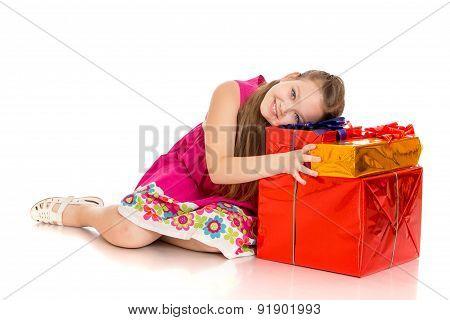 Joyful girl hugs box gift