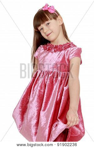 Portrait of little blond in red velvet dress