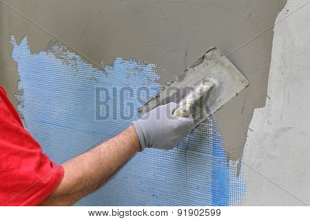 Wall Insulation, Spreading Mortar Over Mesh