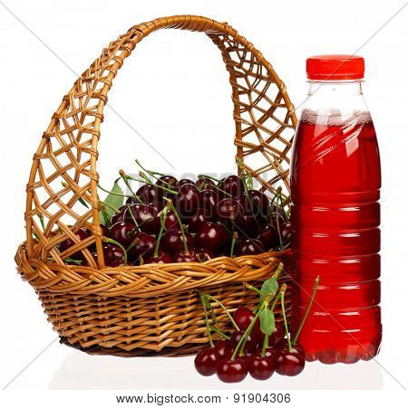 Sweet cherries in a basket and bottled juice on a white background