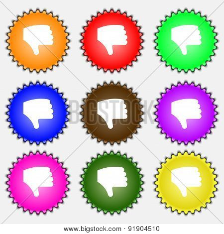 Dislike, Thumb Down, Hand Finger Down  Icon Sign. A Set Of Nine Different Colored Labels. Vector