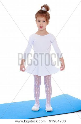 Portrait of little athletes standing on a rubber Mat