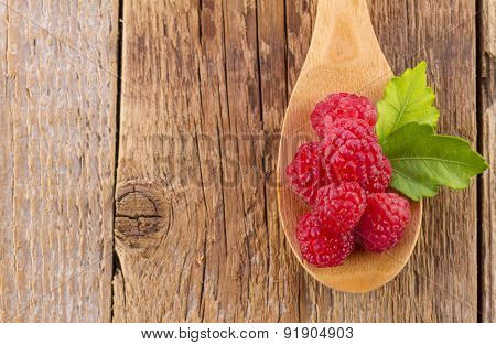 Fresh Raspberries in Wooden Spoon