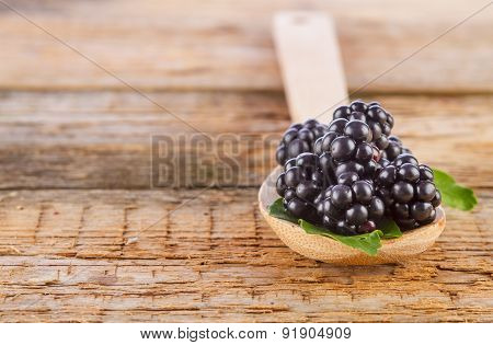 Blackberries with Spoon on Wood