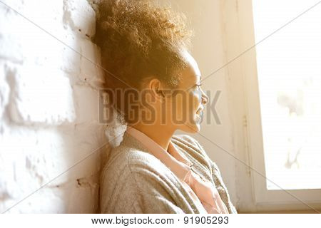 African American Woman Smiling And Looking Out Of Window