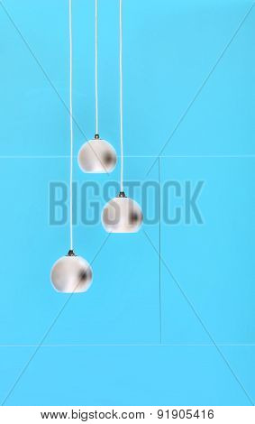 Blue negative collage of three ceiling lights, loft-style interi