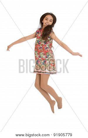 Girl in summer dress jumping