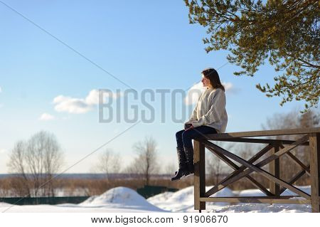 Young pretty woman in the park in winter time