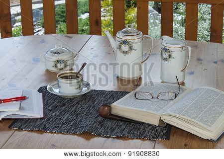 cup of coffee on the terrace, relax with a book, a time for pipe