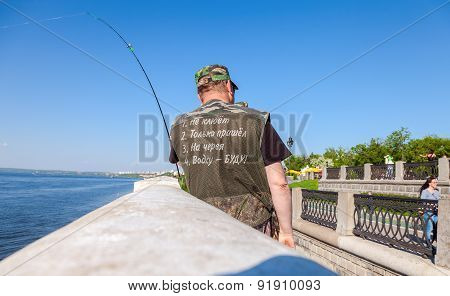 The Fisherman Is Fishing On The Samara Embankment In A Sunny Summer Day