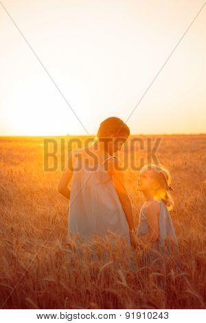 Girls On A Wheat Field